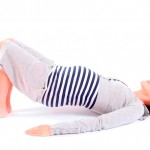 Young pregnant woman exercising pilates
